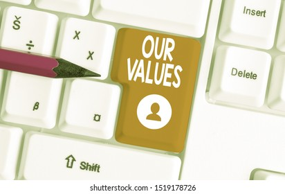 Conceptual hand writing showing Our Values. Business photo text list of morals companies or individuals commit to do them White pc keyboard with note paper above the white background.