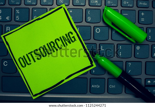 Conceptual hand writing showing Outsourcing. Business photo text Obtain goods or service by contract from an outside supplier Keyboard sticky card marker pen office job computer study class.