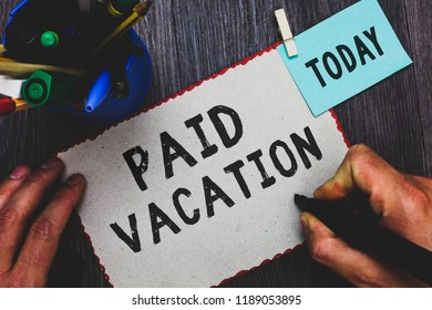 Conceptual hand writing showing Paid Vacation. Business photo text Sabbatical Weekend Off Holiday Time Off Benefits Man holding marker paper clothespin reminder cup marker wood table.