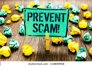 Conceptual hand writing showing Prevent Scam Motivational Call. Business photo showcasing Consumer protection fraudulent transactions Crumpled papers ideas mistakes paperclip clip objects wood.