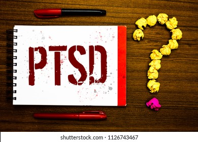 Conceptual hand writing showing Ptsd. Business photo text Post Traumatic Stress Disorder Mental Illness Trauma Fear Depression Marker notepad nice art ask crumpled papers mistakes several tries.