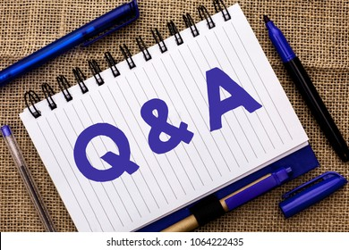 Conceptual hand writing showing Q A. Business photo showcasing Ask Frequently Faq Asked Question Help Solving Doubt Query Support written on Notebook Book on jute background Pens next to it.