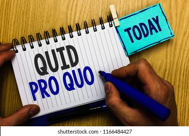 Conceptual hand writing showing Quid Pro Quo. Business photo showcasing A favor or advantage granted or expected in return of something Man holding marker expressing ideas notebook reminder wood.