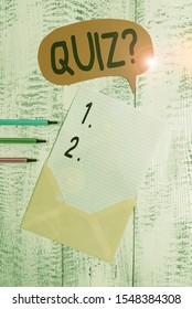 Conceptual hand writing showing Quiz Question. Business photo text test of knowledge as competition between individuals or teams Envelope speech bubble ballpoints lying wooden retro background.