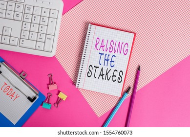 Conceptual hand writing showing Raising The Stakes. Business photo showcasing Increase the Bid or Value Outdo current bet or risk Writing equipments and computer stuff placed on plain table.