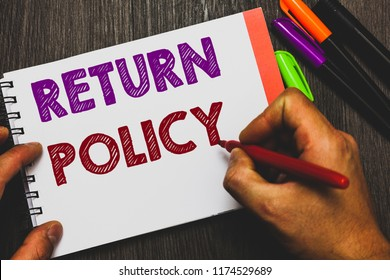 Conceptual hand writing showing Return Policy. Business photo text Tax Reimbursement Retail Terms and Conditions on Purchase Man holding notebook paper communicating ideas Wooden background.