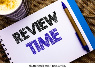 Conceptual hand writing showing Review Time. Business photo showcasing Evaluating Survey Reviewing Analysis Checkup Inspection Revision written on Notebook Book on the jute background Pen and Cup