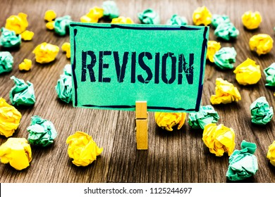 Conceptual hand writing showing Revision. Business photo showcasing Rechecking Before Proceeding Self Improvement Preparation Crumpled papers ideas mistakes paperclip clip objects wood.