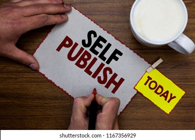 Conceptual hand writing showing Self Publish. Business photo text Published work independently and at own expense Indie Author Man holding marker notebook reminder wooden table cup coffee.