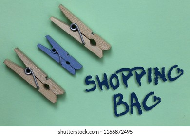 Conceptual hand writing showing Shopping Bag. Business photo showcasing Containers for carrying personal possessions or purchases Three brown blue vintage clear background Holding things.