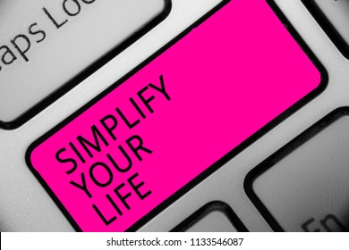 Conceptual hand writing showing Simplify Your Life. Business photo showcasing Manage your day work Take the easy way Organize Text script message button symbol typing keyboard idea.