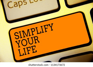 Conceptual hand writing showing Simplify Your Life. Business photo text Manage your day work Take the easy way Organize Button alphabets script keyboard text idea computer symbol notice.