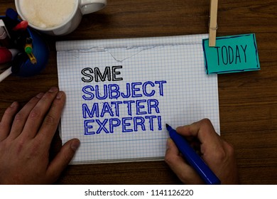 Conceptual hand writing showing Sme Subject Matter Expert. Business photo showcasing Authority in a particular area or topic Domain Hand hold pen paper clip written notepad pen case coffee mug.