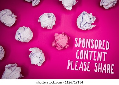 Conceptual hand writing showing Sponsored Content Please Share. Business photo text Marketing Strategy Advertising Platform Ideas pink background crumpled papers trial mistakes several tries.