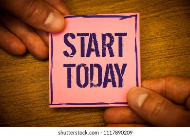 Conceptual hand writing showing Start Today. Business photos text Initiate Begin right now Inspirational Motivational phraseMan hold holding pink note ideas black letters and wooden background