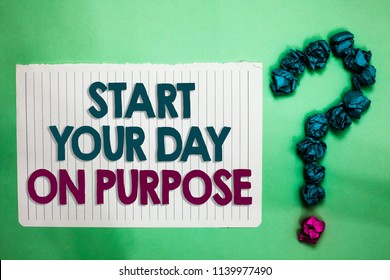 Conceptual hand writing showing Start Your Day On Purpose. Business photo text Have clean ideas of what you are going to do white notepad with words teal blue lobs form greenery background.