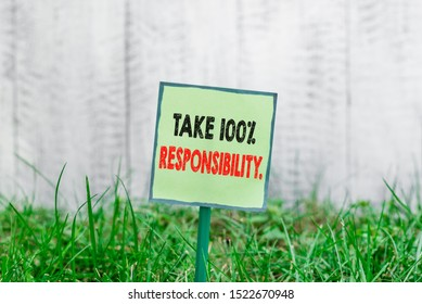 Conceptual hand writing showing Take 100 Percent Responsibility. Business photo showcasing be responsible for list of things objects to do Plain paper attached to stick and placed in the grassy land.
