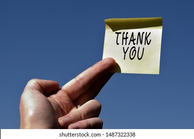 Conceptual hand writing showing Thank You. Business photo text a polite expression used when acknowledging a gift or service Square paper piece notation stick to textured glass window.