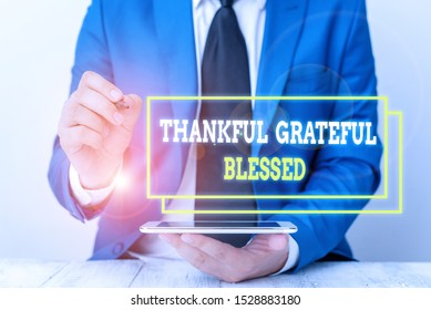 Conceptual hand writing showing Thankful Grateful Blessed. Business photo text Appreciation gratitude good mood attitude Businessman pointing with pen in empty copy space.