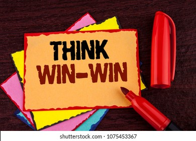 Conceptual hand writing showing Think Win-Win. Business photo showcasing Negotiation strategy for both partners to obtain benefits written on Sticky note paper on wooden background Marker.