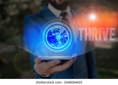 Conceptual hand writing showing Thrive. Business photo showcasing Think positively Continue to prosper and flourish Time to Blossom Elements of this image furnished by NASA.