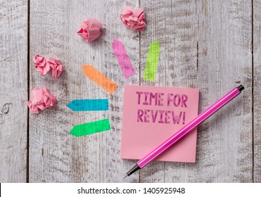 Conceptual hand writing showing Time For Review. Business photo text formal assessment of something with intention instituting change Note paper and line arrow stickers on the top of wooden table desk