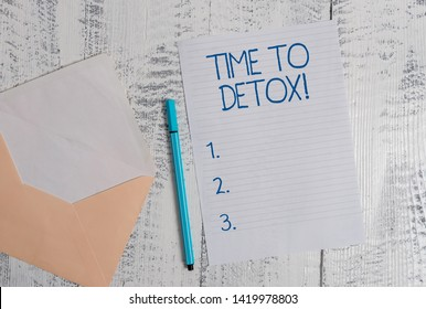 Conceptual hand writing showing Time To Detox. Business photo showcasing when you purify your body of toxins or stop consuming drug Colored envelope blank sheet ballpoint wooden background.