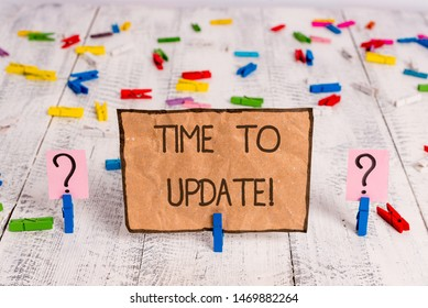 Conceptual hand writing showing Time To Update. Business photo text act updating something someone or updated version program Crumbling sheet with paper clips placed on the wooden table.