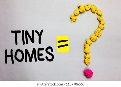 Conceptual hand writing showing Tiny Homes. Business photo showcasing houses contain one room only or two and small entrance Cheap Crumpled forming question mark equal sign white background.