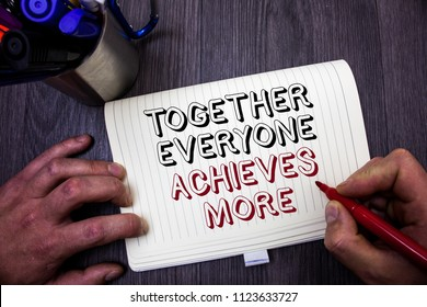 Conceptual hand writing showing Together Everyone Achieves More. Business photo showcasing Teamwork Cooperation Attain Acquire Success Man hold holding red marker notebook table messages ideas.