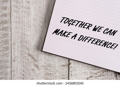 Conceptual hand writing showing Together We Can Make A Difference. Business photo showcasing be very important some way in like team or group Notebook stationary placed above classic wooden backdrop.