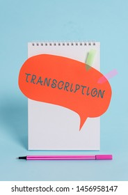 Conceptual hand writing showing Transcription. Business photo text Written or printed version of something Hard copy of audio Spiral notepad speech bubble arrow pen lying pastel background.