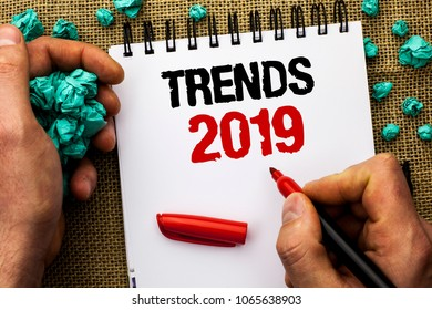 Conceptual hand writing showing Trends 2019. Business photo text Current Movement Latest Branding New Concept Prediction written by Man Holding Marker on Notebook Book on jute background