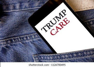 Conceptual hand writing showing Trump Care. Business photo text refers to replacement for Affordable Care Act in united states Cell phone white screen message application wicker background.