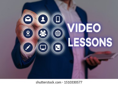Conceptual hand writing showing Video Lessons. Business photo text Online Education material for a topic Viewing and learning.