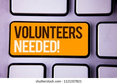 Conceptual hand writing showing Volunteers Needed Motivational Call. Business photo text Social Community Charity Volunteerism Gray color polished keyboard with yellow button black white text.
