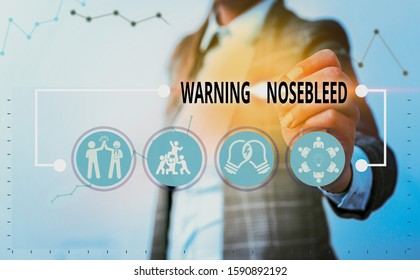 Conceptual hand writing showing Warning Nosebleed. Business photo showcasing caution on bleeding from the blood vessels in the nose.