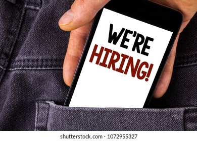Conceptual hand writing showing We Are Hiring Motivational Call. Business photo text Workforce Wanted New Employees Recruitment written Mobile Phone holding by man the Jeans background.