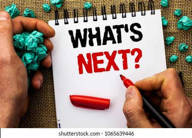 Conceptual hand writing showing What s Next Question. Business photo text Asking Imagination Choice Solution Next Questionaire written by Man Holding Marker on Notebook Book on jute background