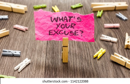 Conceptual hand writing showing What s is Your Excuse question. Business photo showcasing Explanations for not doing something Inquiry Paperclip hold pink note with texts many clips wooden floor.