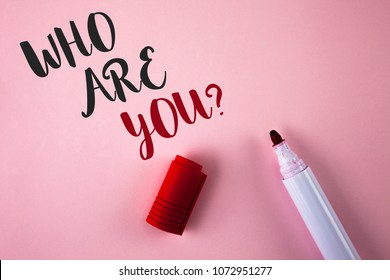 Conceptual hand writing showing Who Are You Question. Business photo showcasing Introduce or Identify Yourself Tell your Personal Story written Plain Pink background Marker next to it.