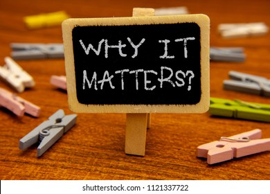 Conceptual hand writing showing Why It Matters Question. Business photo showcasing Important Reasons to do something Motivation Goal Blackboard chalk letters clothespin with wooden background.