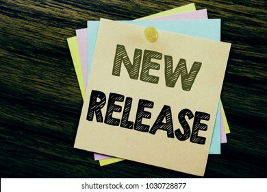 Conceptual hand writing text caption inspiration showing New Release . Business concept for Technology Software Update written on sticky note paper on the wooden background.