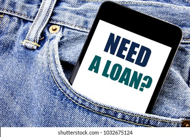 Conceptual hand writing text caption inspiration showing Need A Loan Question. Business concept for Mortage Credit Written phone mobile phone, cellphone placed in man front jeans pocket.