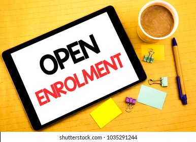 Conceptual hand writing text caption showing Open Enrolment. Business concept for Medicine Doctor Enroll Written on tablet, wooden background with sticky note and pen