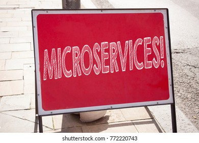 Conceptual hand writing text caption inspiration showing Microservices. Business concept for Micro Services written on announcement road sign with background and copy space