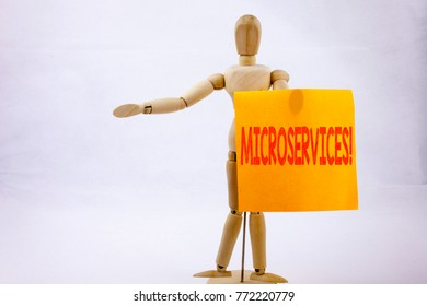 Conceptual hand writing text caption inspiration showing Microservices Business concept for Micro Services written on sticky note sculpture background with space