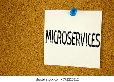 Conceptual hand writing text caption inspiration showing Microservices. Business concept for  Micro Services written on sticky note, reminder cork background with copy space