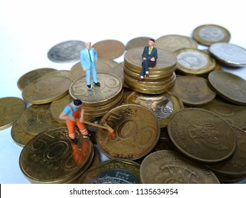 conceptual Illustration for Money Laundry Activity, worker mini figure toy cleaning golden indonesia rupiah coin