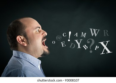 Conceptual image. Angry man shouting against black background with letters coming out from his mouth.